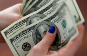 Dollar Rebounds From Lows as Fed Ups Growth Outlook, Signals Low Rates to Continue